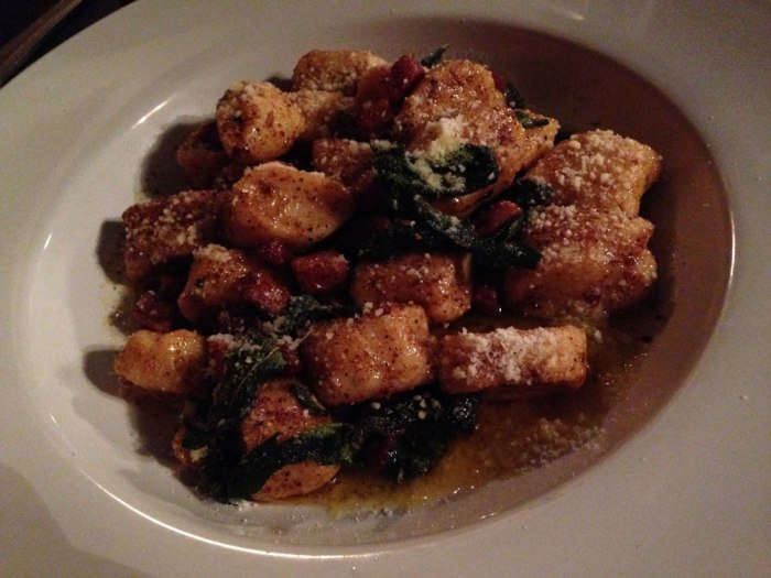 Cosa's ricotta gnocchi is served in brown butter with pancetta and parmigiano reggiano.